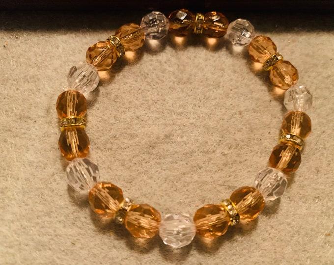 Sparkly peach colored beaded stretch bracelet