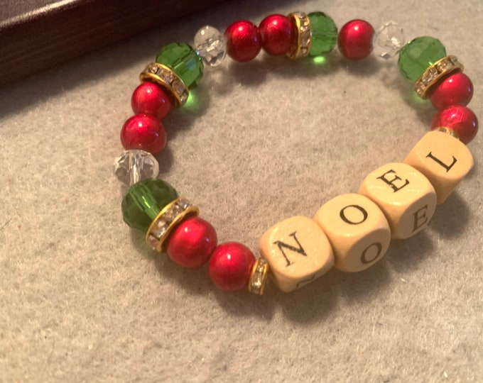 Holiday colored Beaded Stretch Bracelet with NOEL in wooden beads