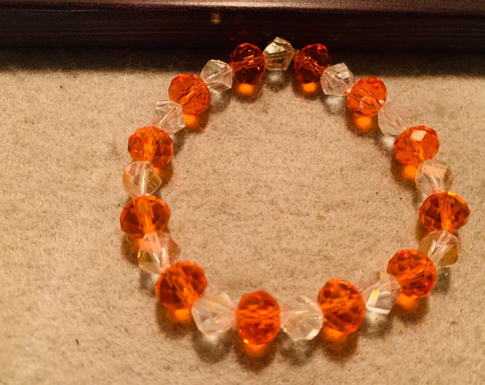 Sparkly orange and clear  beaded stretch bracelet