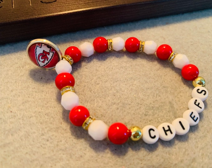 Red/White/Gold Beaded Stretch Bracelet with charm (pictured)
