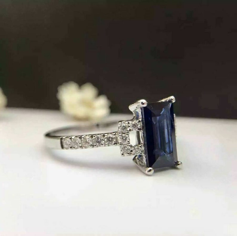 1.50ct Emerald Cut Blue Sapphire Solitaire Engagement Ring In 14K White Gold Finish Sterling Silver