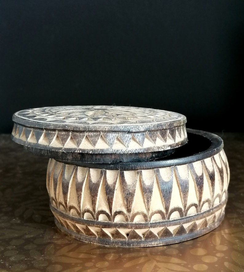 Hand made and tinted on the outer surface. Carved with flower and geometric pattern Unique Vintage Wooden Trinket Box