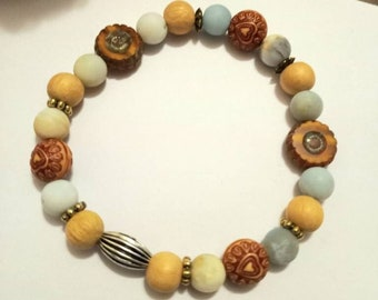 Diffuser bracelet//8mm Amazonite //Jackfruit Wood beads 8mm// Burnt Orange Flower Coin beads// Acrylic etched heart beads// stretch cord.