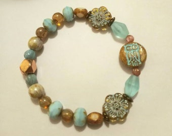 Czech Glass Aqua Owl pressed glass 14mm// Amber Aqua glass beads//Rose Gold Brass Spacer bead//Turquoise glass Rondell beads.