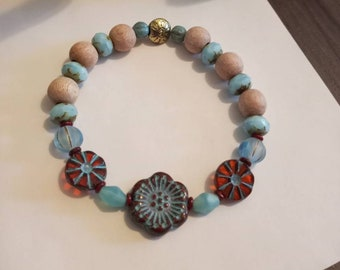 Premium Czech Glass, Wild Rose red with light blue 18mm focal, Light blue Melon and Rondell, Unwaxed Rosewood beads. Aromatherapy. Diffuser.