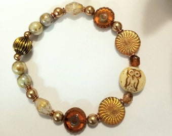 Czech Glass 14mm Owl bead//Amber Gold Patterned beads// Coffee glass Pearls// 14mm Laser Tatoo Bronze Swirl Coin beads// Green Luster beads.