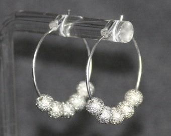 Vikita   silver stardust circle metallic shimmery bead hoop earrings