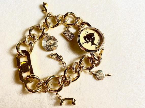 Charming Barbie Fossil gold charm bracelet watch