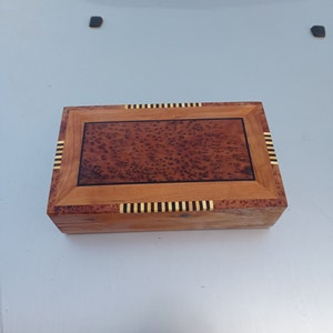 Jewelry box opens into four small boxes Material Thuya Wood