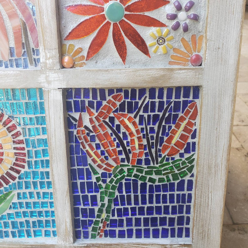 Mosaic stained glass flowers in a window.
