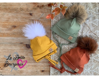 Unlined toque with flap, ears and cords with removable fur pompom
