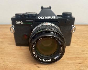 Olympus OM2 Spot Program 35 mm film camera + 50 mm f1:4 Zuiko fast standard lens - Near mint condition