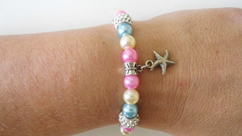 Bracelet étoile de mer perles nacrées et breloques en France image 0
