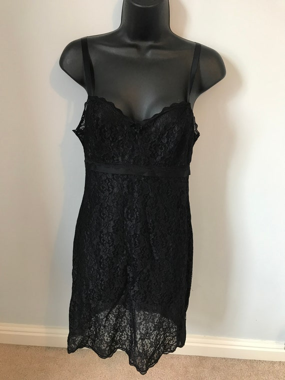 Beautiful and elegant black lacy negligee chemise