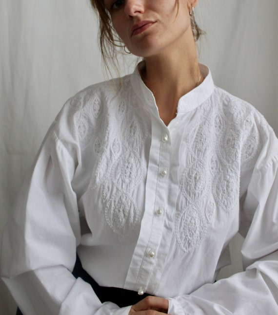 White blouse in folklore style with puff sleeves,