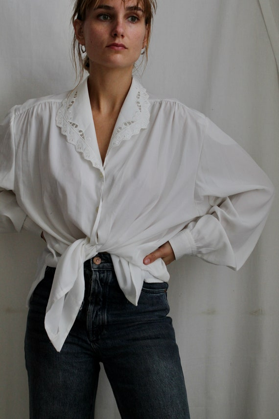 White vintage blouse with lace collar in folklore