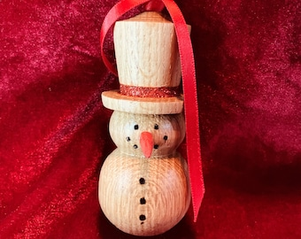 Hand turned oak wooden snowman Christmas tree decoration with red band on hat