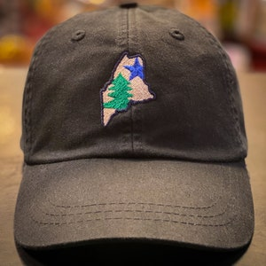 Embroidered Vintage Maine Flag on a  Midnight Blue Adams Adult Game Changer Soft Trucker Hat