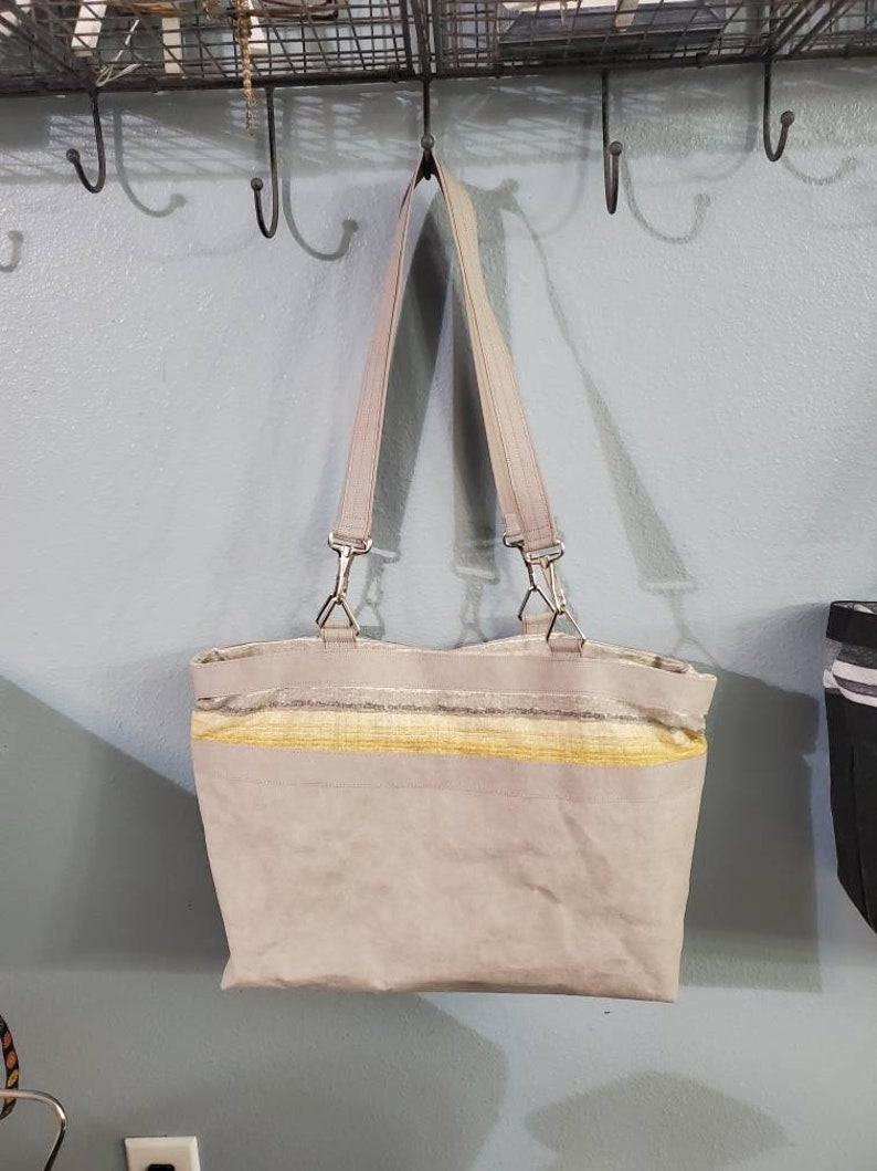 drawstring closure Project or Tote bag: versatile as a smaller tote inner pockets outer pocket with Kraft-tex taller tote
