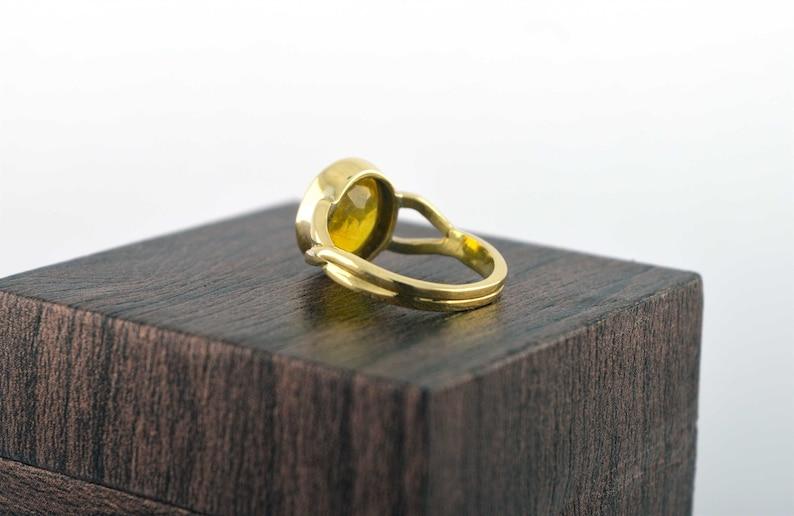 oval gemstone ring in panchdhatu metal for vedic astrology jupiter planet November birthstone pukhraj Natural yellow sapphire