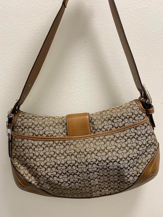 Coach signature handbag.