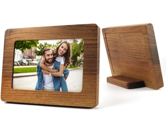 Precious wood picture frame, made of walnut.