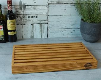 Bread board with removable acacia crumb compartment
