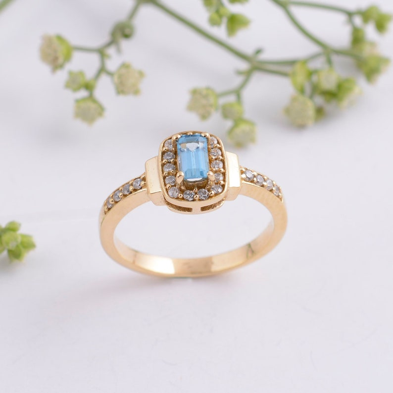 Blue crystals bring you patience and respect. A gorgeous blue Tourmaline ring with white Zircons is going to add a glimpse to your day