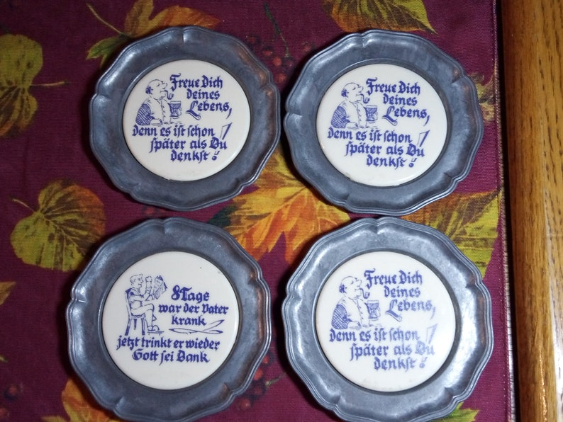 Angle mark made with pewter. Vintage set of four German beer coasters