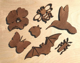 Pollinator Posse Charity Fundraiser | Pollinator Pack Hanging Ornaments | UV reactive | Lasercut Painted Wooden Figures | Blacklight Décor