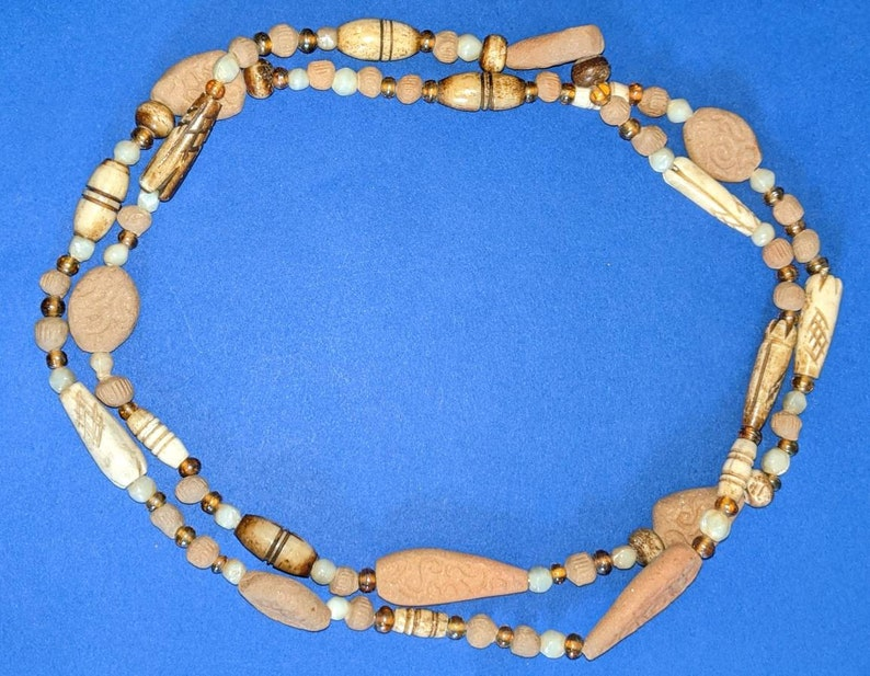 Vintage hand carved clay and bone beaded necklace.