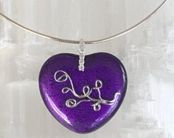 Dichroic glass pendant and fine silver .999 fused on heart pattern glass.