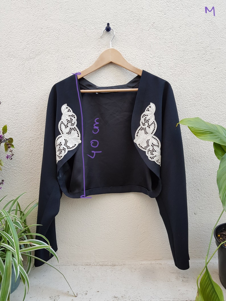 Black and white vintage jacket with guipure lace jacket style and open vest cut spencer