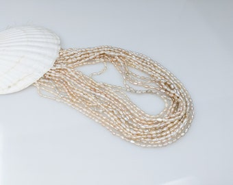 Cream Chinese Freshwater Long Rice Krispies  2.5-3.0 by 8.5mm pearl strand