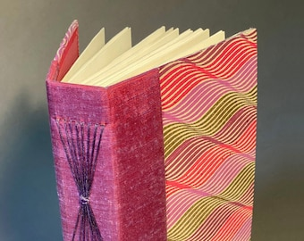 Hand bound Longstitch Journal with unique paper. Made To Order