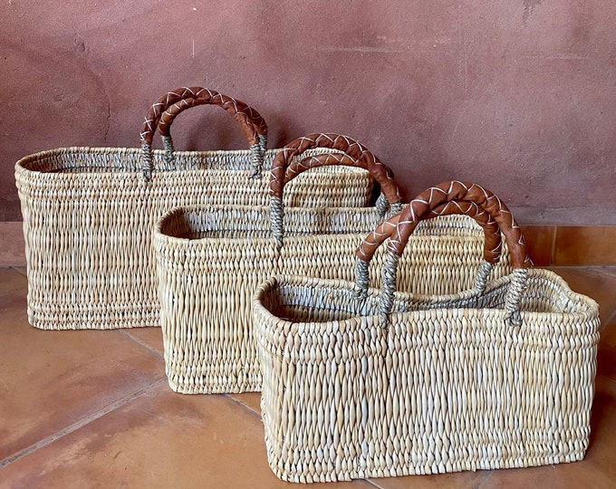 Palm leaf basket and leather handles