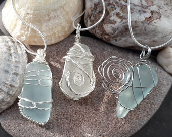 Clear Sea Glass Pendant hand wrapped in silver plate wire.