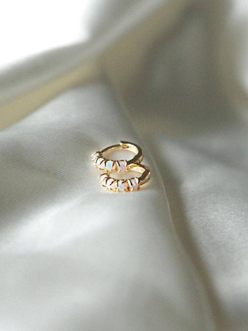 Opal encrusted 24k gold huggie hoop earrings