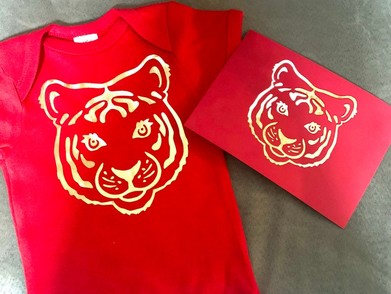 Red egg and ginger gift Matching tiger onesie and envelope