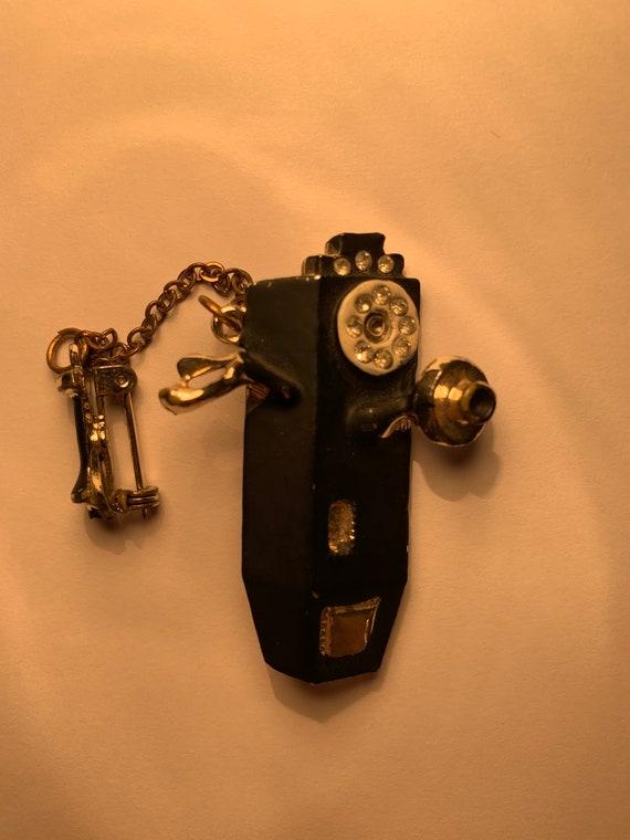 Black pay phone pin