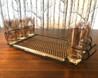 Six Georges Briard gold glasses with caddy