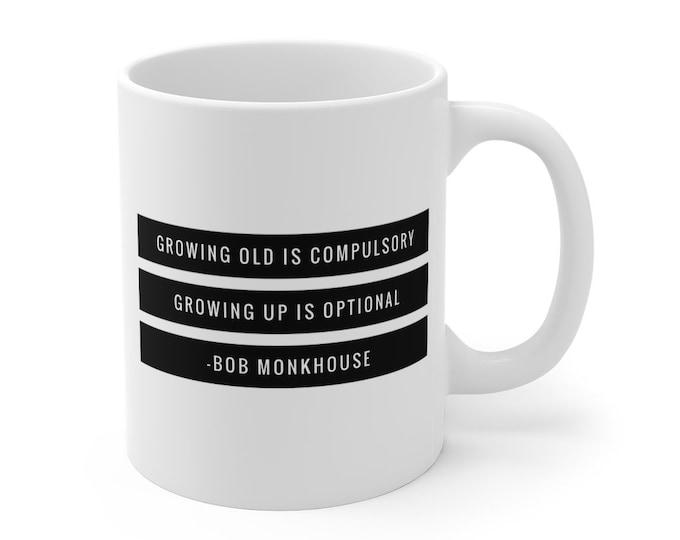 Bob Monkhouse Quote - Growing old is compulsory, growing up is optional -  Mug - 11oz
