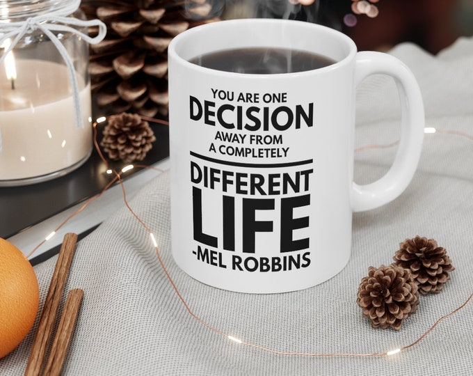 MEL ROBBINS quote - You Are One Decision Away From A Completely Different Life - 11oz White Mug