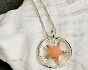 Copper star pendent necklace set in a chunky Sterling Silver circle, a handmade unique design.