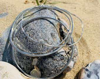 """Set of three Sterling Silver Bangles, Handmade with Stunning Coastal Textures, New Collection """"Ripples in the Sand""""."""