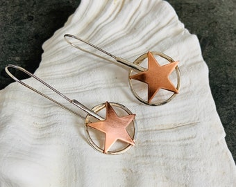 Copper star drop earrings set in a chunky Sterling Silver circle, a handmade unique design.