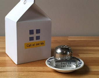 "Tea ball and his plate ""Call of due tea"""