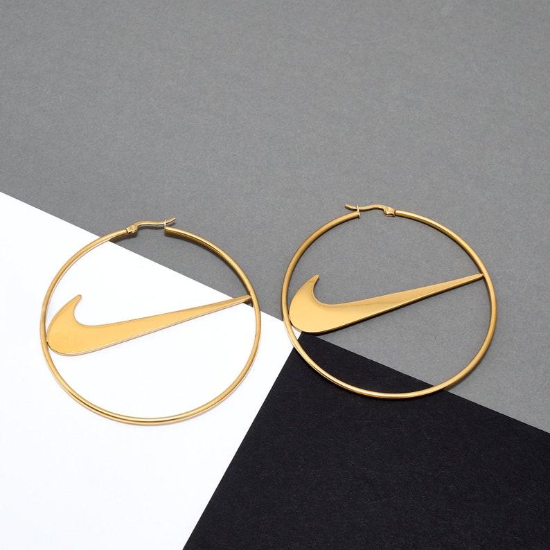 Large Nike inspired hoop earrings gold stainless steel swoosh image 0