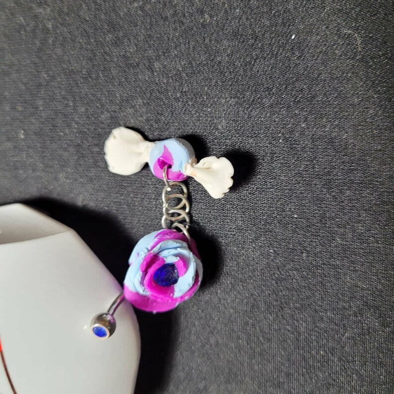 Blue and violet rose belly barbell with wrapped candy dangle