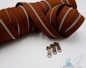 1 m endless zipper incl. 3 zippers - narrow metallized bourbon - old brass